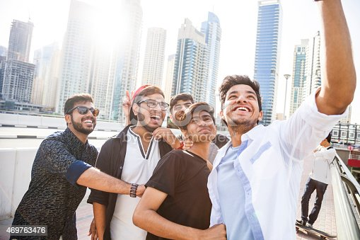 469416394 istock photo Friends taking a selfie in Dubai Marina during a vacation 469763476