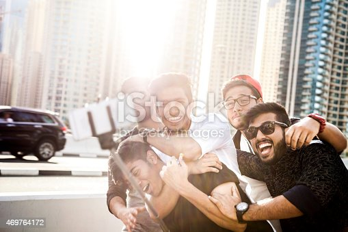 469416394 istock photo Friends taking a selfie in Dubai Marina during a vacation 469764172