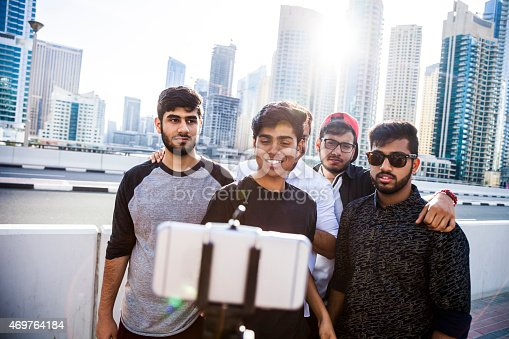 469416394 istock photo Friends taking a selfie in Dubai Marina during a vacation 469764184