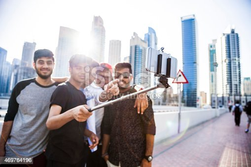 469416394 istock photo Friends taking a selfie in Dubai Marina during a vacation 469764196