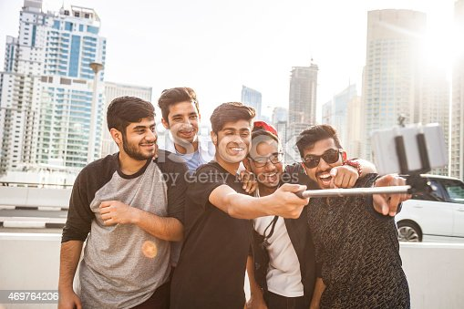 469416394 istock photo Friends taking a selfie in Dubai Marina during a vacation 469764206