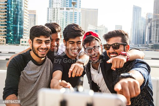 469416394 istock photo Friends taking a selfie in Dubai Marina during a vacation 469764228