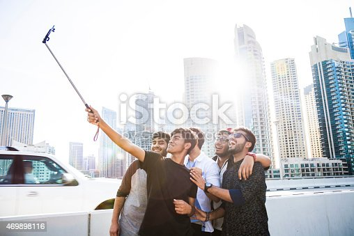 469416394 istock photo Friends taking a selfie in Dubai Marina during a vacation 469898116