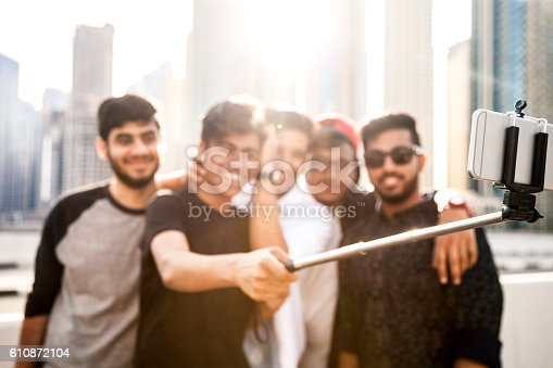 469416394 istock photo Friends taking a selfie in Dubai Marina during a vacation 610872104