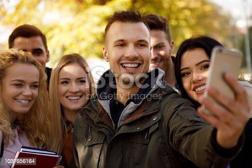 istock Friends taking a selfie outdoors 1037656164