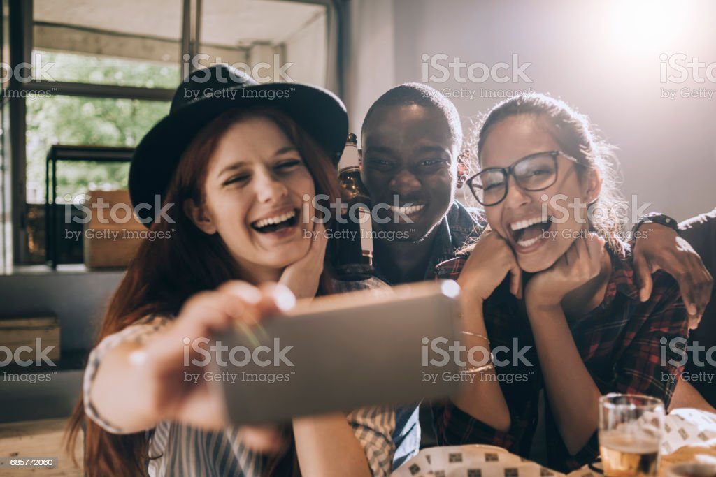 friends taking a selfie royalty-free stock photo