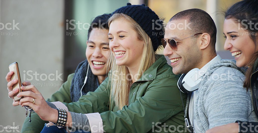 Friends Taking a Selfie Together stock photo