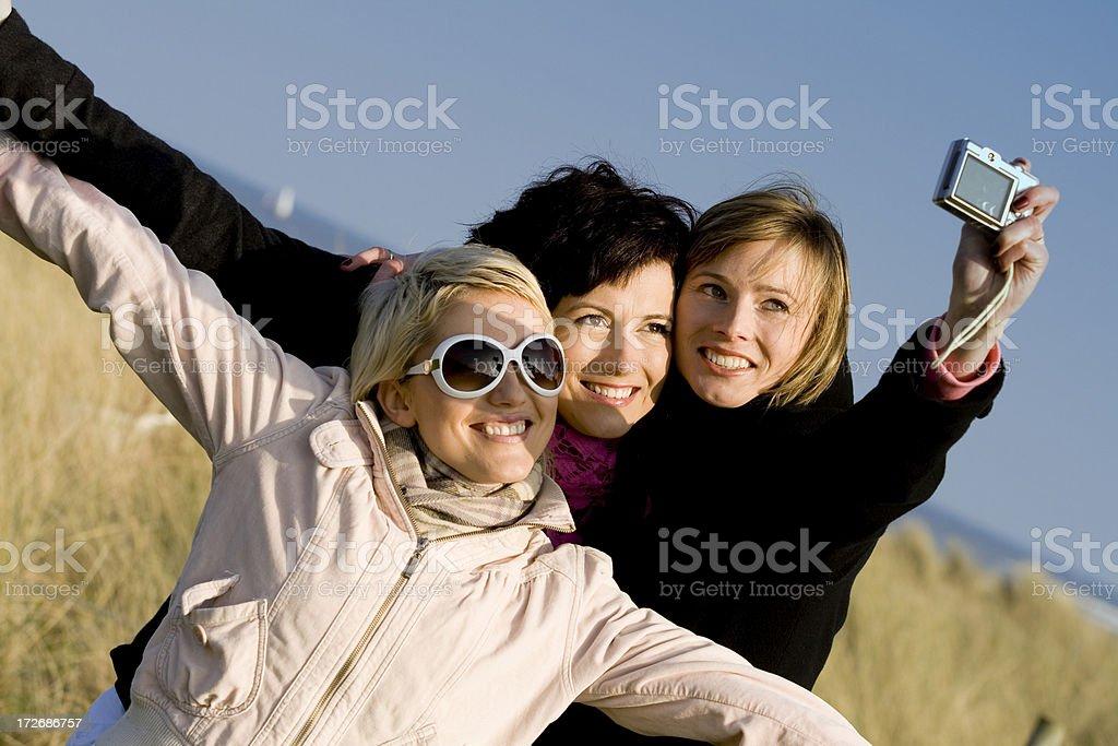 Friends taking photo royalty-free stock photo