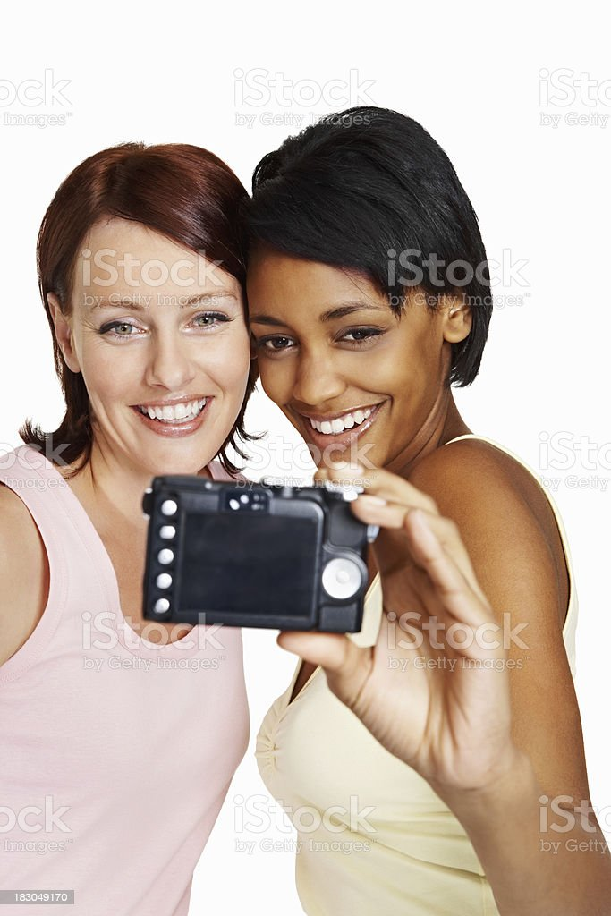 Friends taking photo with a digital camera against white royalty-free stock photo