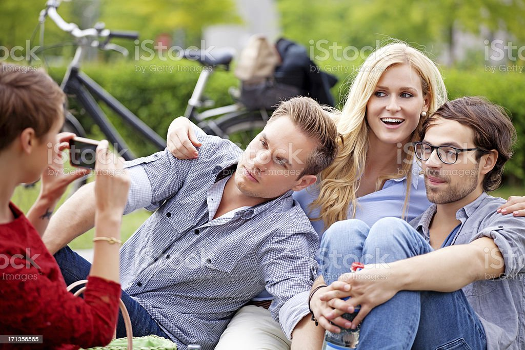 friends taking pictures outdoors stock photo