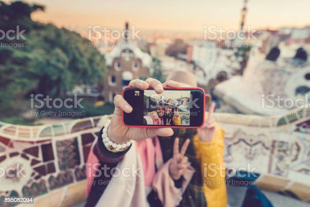 Friends taking selfie at park guellbarcelona picture id895082094?b=1&k=6&m=895082094&s=612x612&h=bzcwdacufxfn4bj93uf 3kynh nosvn12jxb0p1yiny=