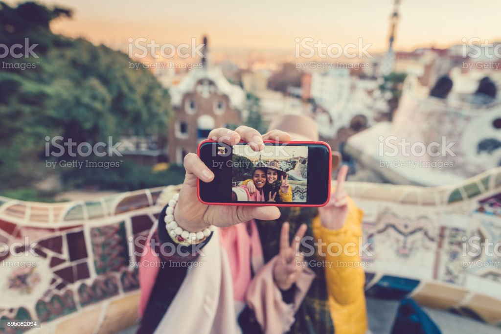 Friends taking selfie at Park Guell,Barcelona stock photo
