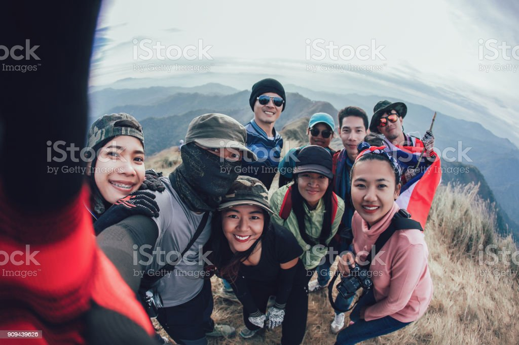 Friends Taking Selfie at the top of mountain stock photo