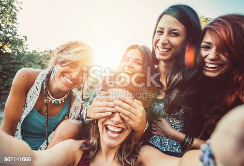 istock Friends taking selfie in the park 962141066