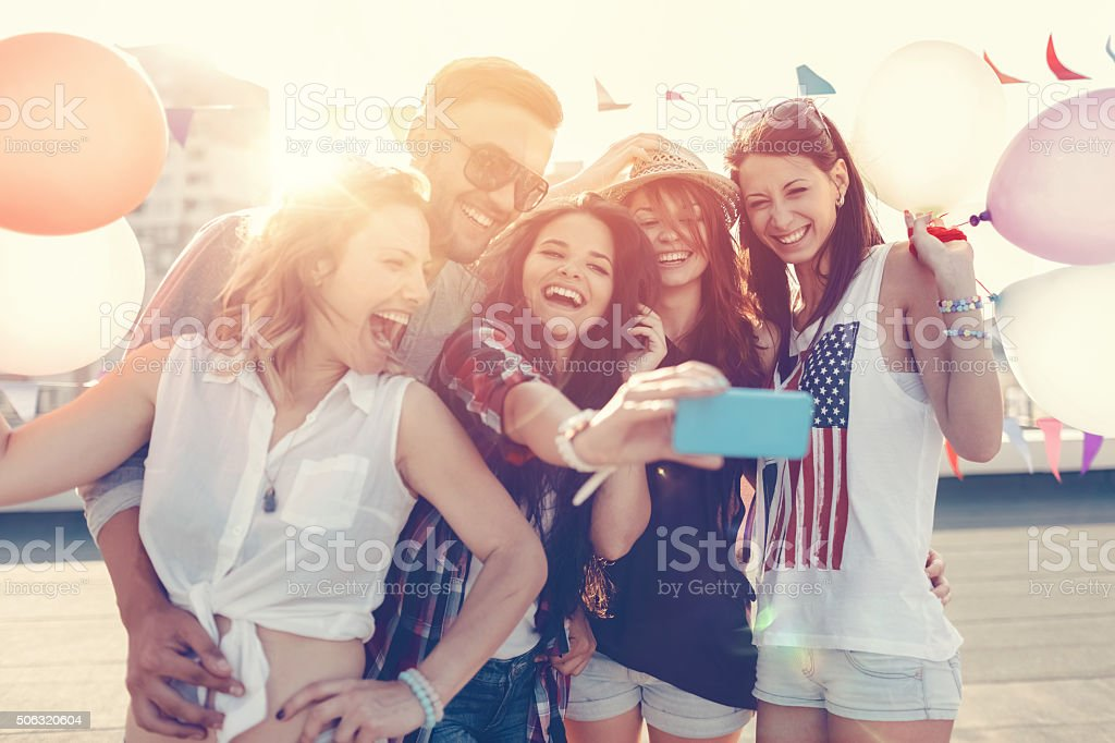 Friends taking selfie on the rooftop stock photo