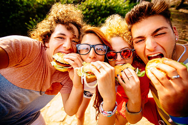 2,229 Teen Eating Burger Stock Photos, Pictures & Royalty-Free Images -  iStock