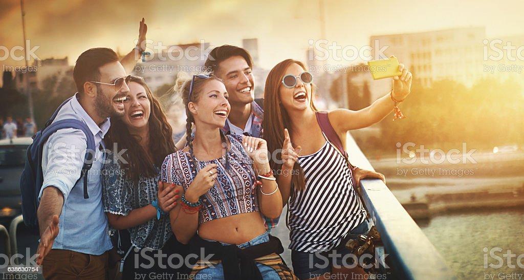 Friends taking selfies. stock photo