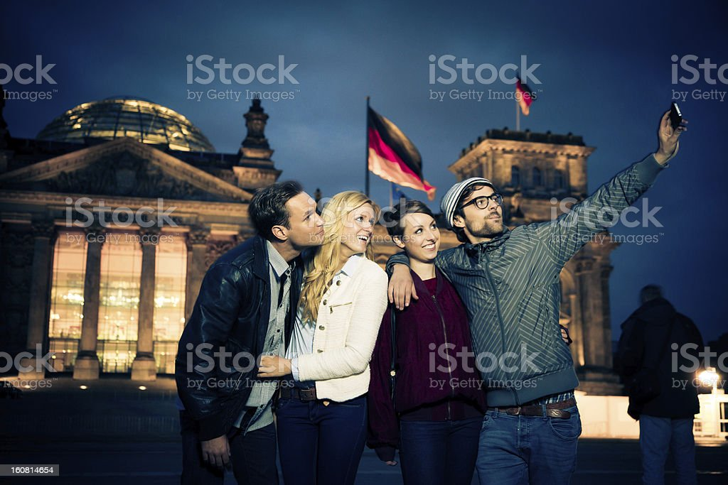 friends taking their picture in front of the reichstag royalty-free stock photo