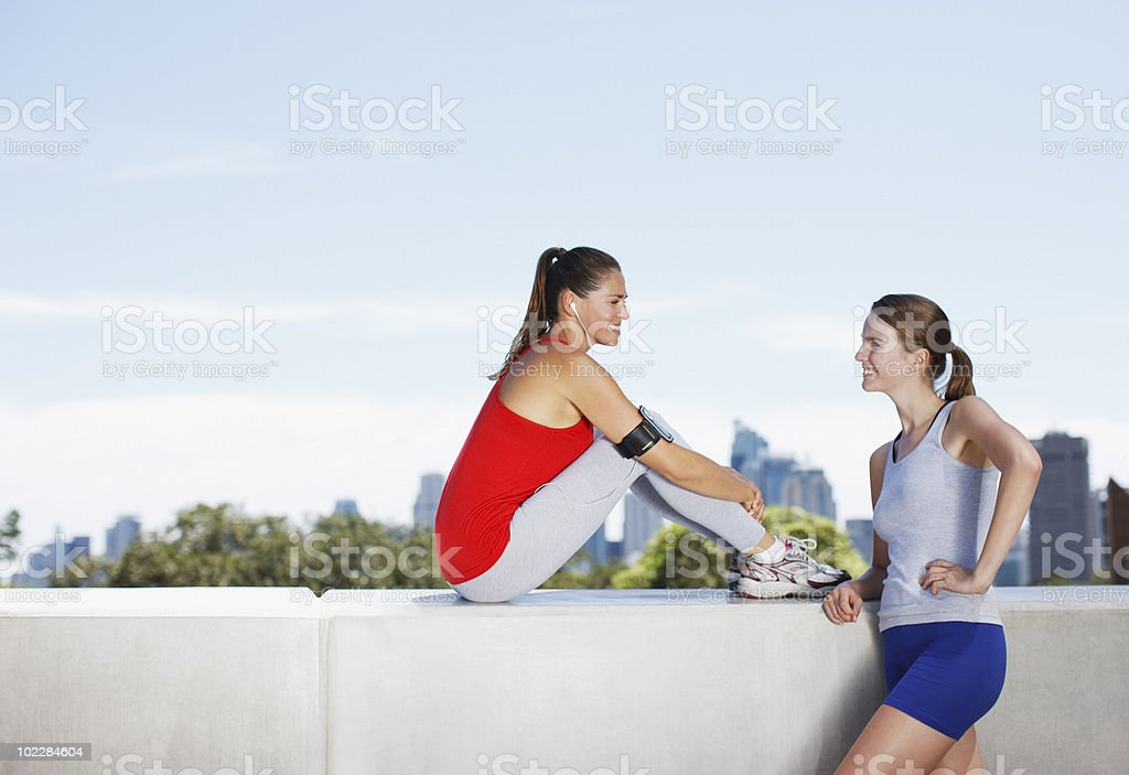 Friends talking after exercise royalty-free stock photo