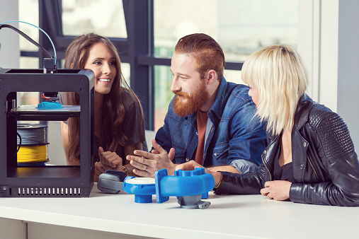 Friends Talking In 3d Printer Office Stock Photo - Download Image Now