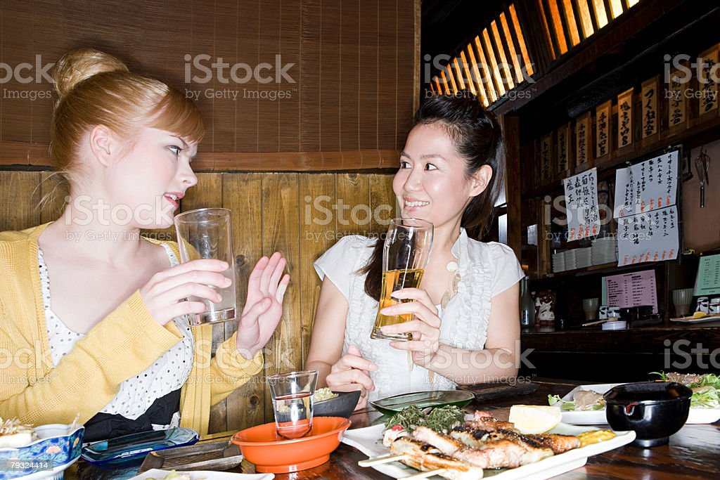Friends talking in a bar royalty-free stock photo