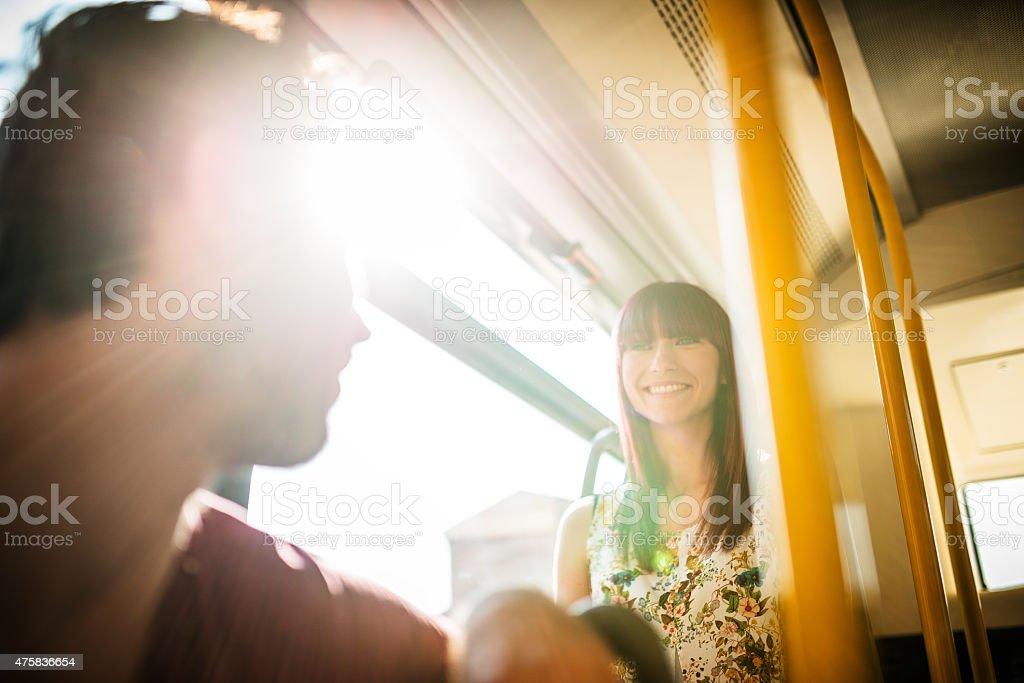 Friends talking in a bus stock photo