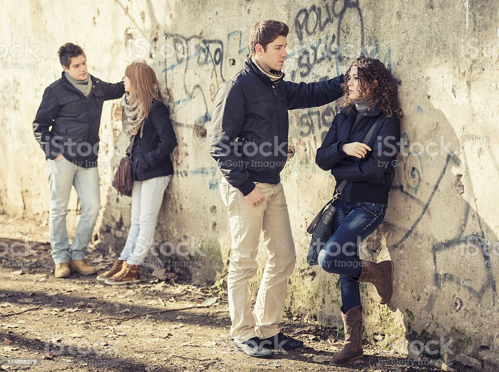 Friends talking on the wall royalty-free stock photo
