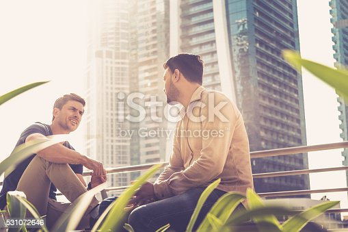istock Friends talking outside their office building 531072646