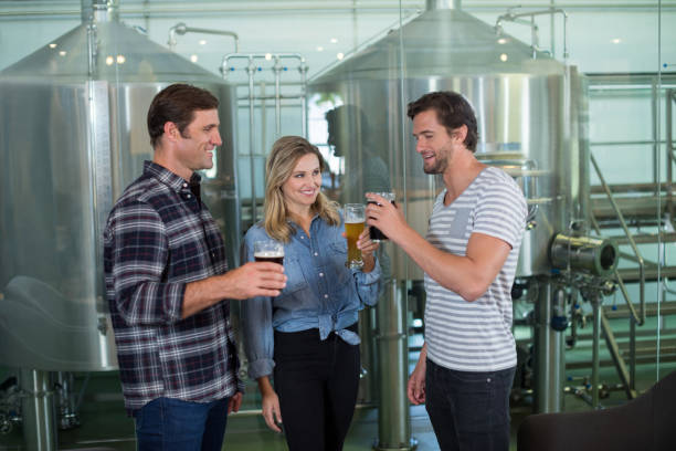 Friends tasting beer stock photo
