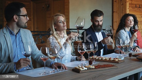 istock Friends tasting wine together 1128709317