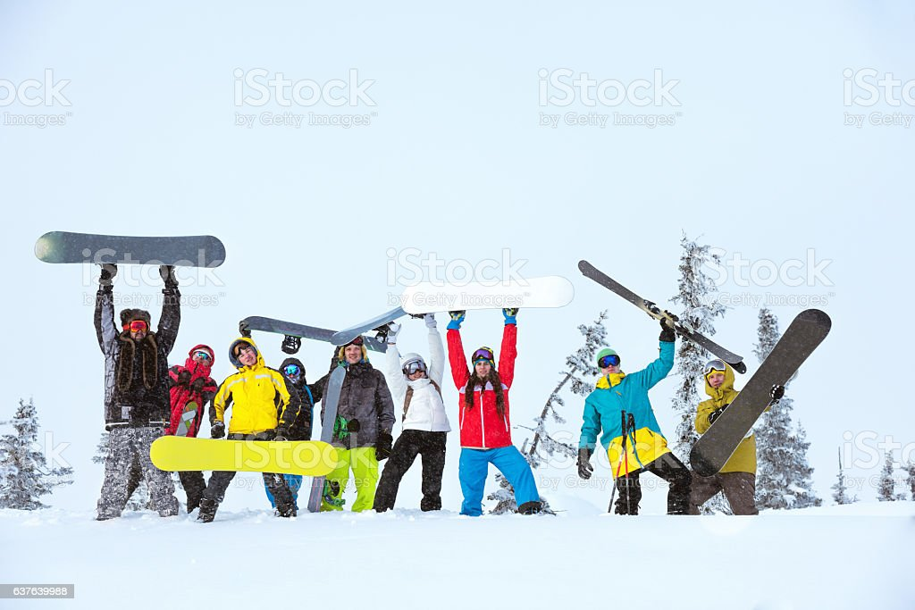 friends team group skiers snowboarders stock photo
