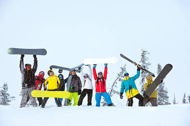 friends team group skiers snowboarders Group of happy friends skiers and snowboarders posing at off-piste slope ski holiday stock pictures, royalty-free photos & images