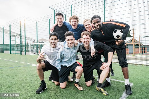 istock Friends team portrait before football kickabout 954142696