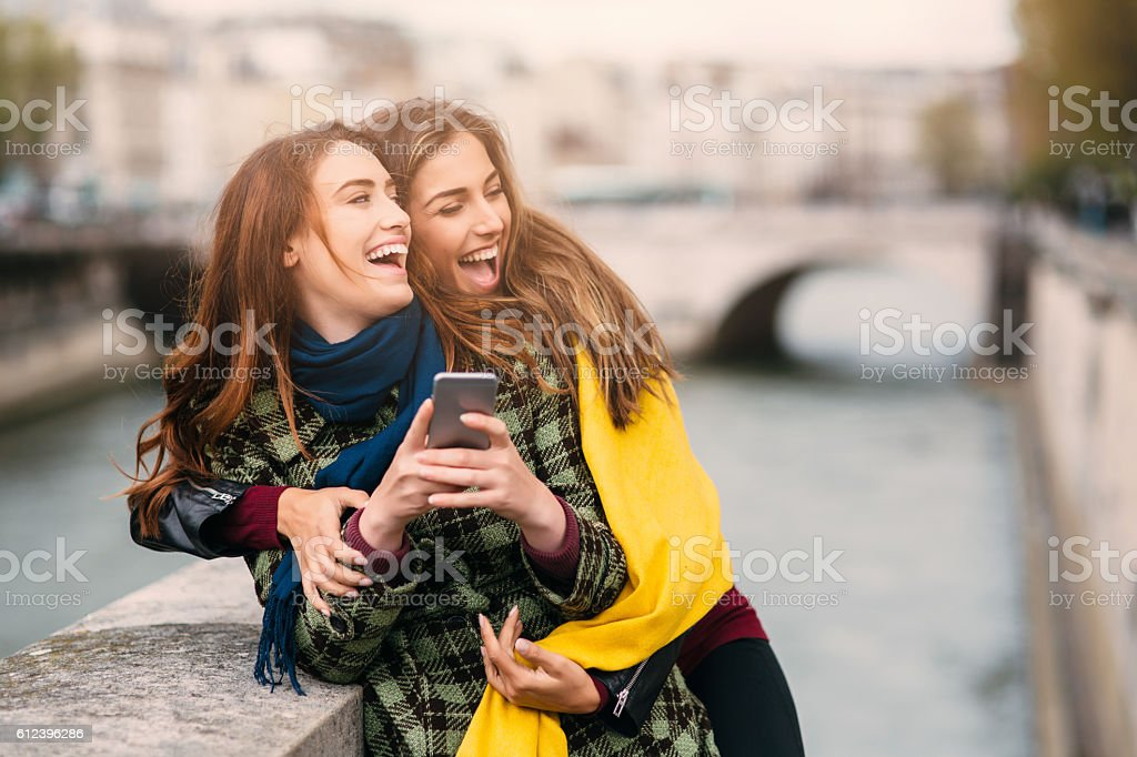 Friends texting in Paris stock photo