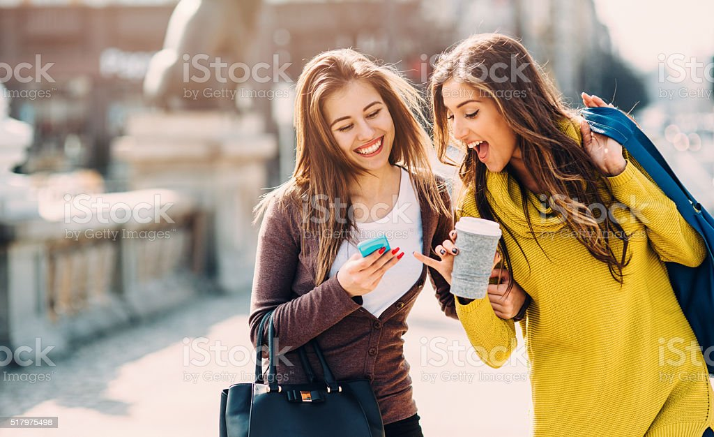 Friends Texting Outside stock photo