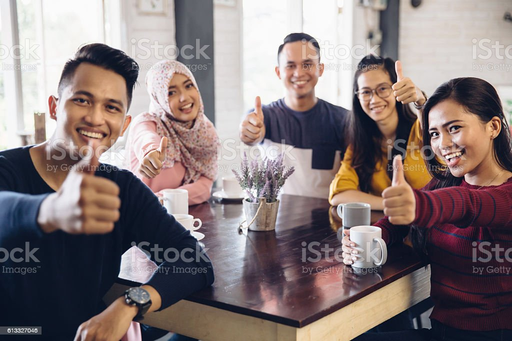 Friends Thumbs up stock photo