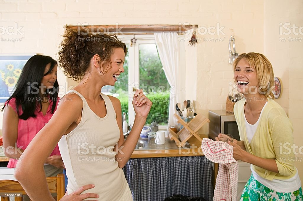 Friends tidying up royalty-free stock photo