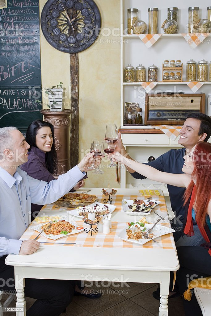 Friends toast with red wine stock photo