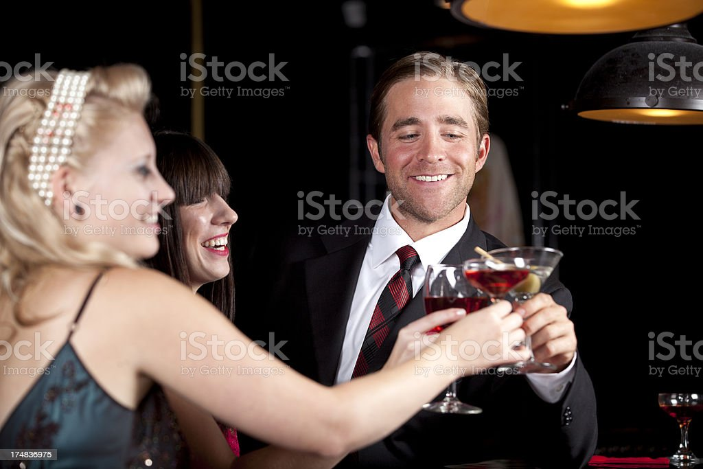 Friends Toasting at a Bar stock photo