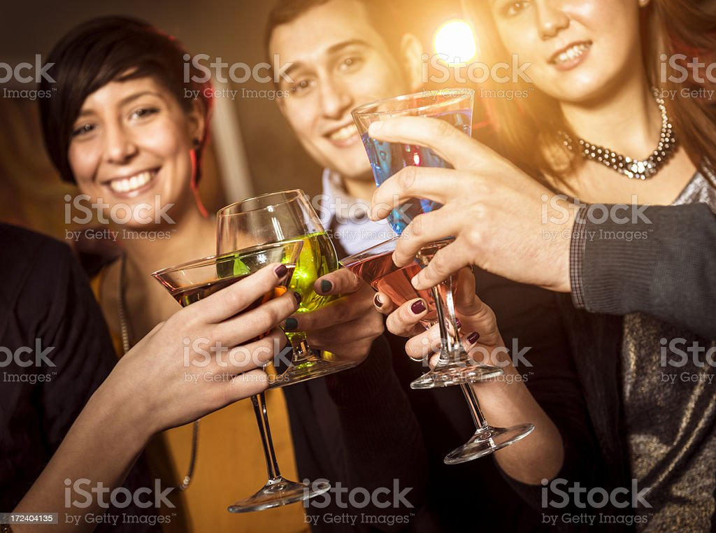 friends toasting at the disco royalty-free stock photo