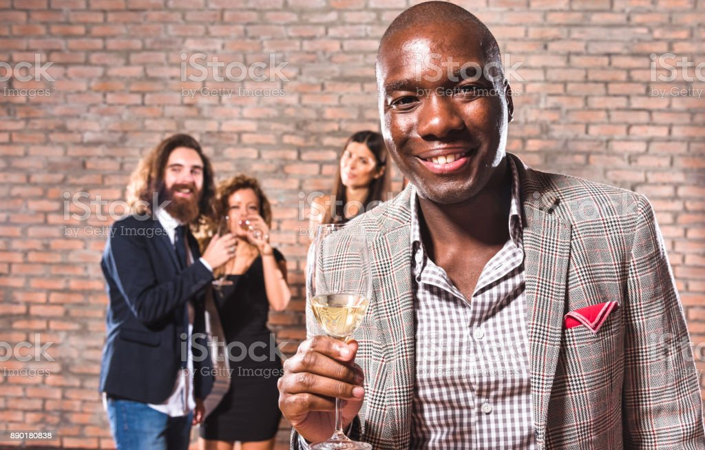 friends toasting at the party for the new year stock photo