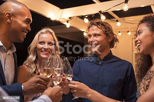 istock Friends toasting champagne glasses 969234288