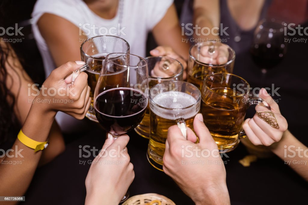 Friends toasting drinks at nightclub stock photo
