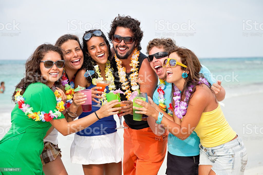 Friends toasting during beach party royalty-free stock photo