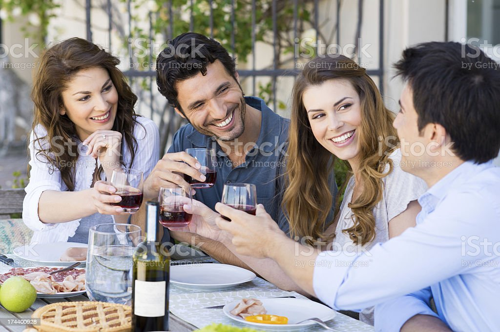 Friends Toasting Wine Glass stock photo
