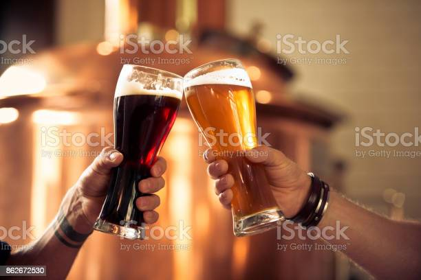 Friends toasting with beer glasses in the microbrewery picture id862672530?b=1&k=6&m=862672530&s=612x612&h=tbal9fwozi1x7vafio2vbfcip4wp8ogvvipceqwie2a=