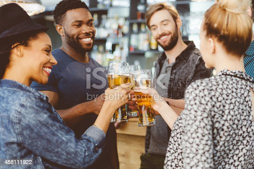 istock Friends toasting with beer in a pub 488111922