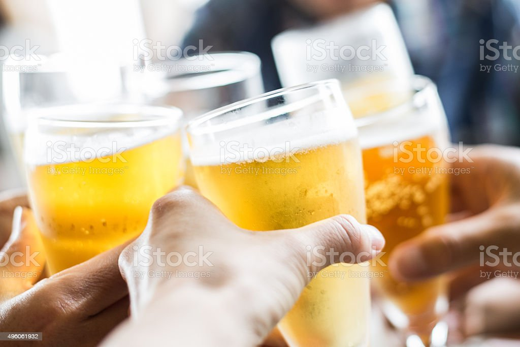 Friends toasting with beer​​​ foto