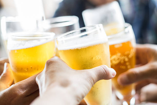 friends toasting with beer - happy hour stock photos and pictures