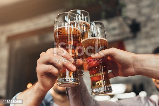 istock Friends toasting with glasses of beer at the pub 1135539666